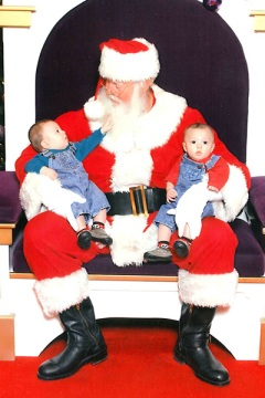 The twins sit on Santa's lap